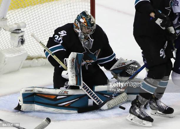 Aaron Dell of the San Jose Sharks makes a save against the Vancouver Canucks at SAP Center on March 2 2017 in San Jose California