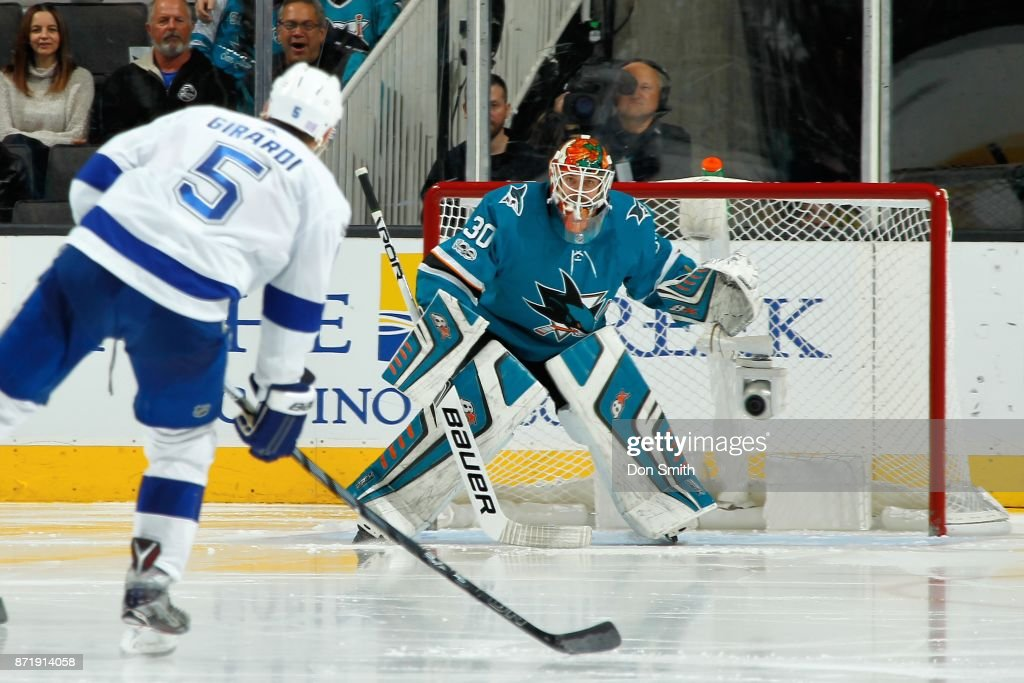 Aaron Dell #30 of the San Jose Sharks protects the net from Dan Girardi #5 of the Tampa Bay Lightning at SAP Center on November 8, 2017 in San Jose, California.