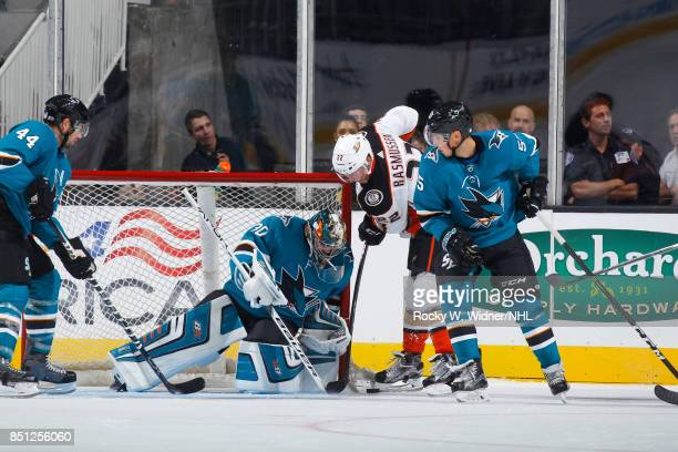 Aaron Dell of the San Jose Sharks saves the puck against Dennis Rasmussen of the Anaheim Ducks at SAP Center on September 19 2017 in San Jose...