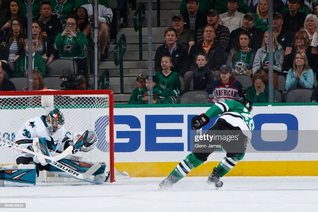 Aaron Dell #30 of the San Jose Sharks slides over to make a desperation stop against Brett Ritchie #25 of the Dallas Stars at the American Airlines Center on March 20, 2017 in Dallas, Texas.