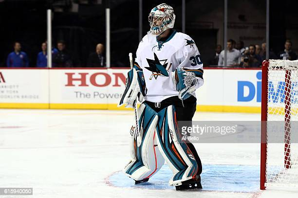 Aaron Dell of the San Jose Sharks stands in gaal against New York Islanders at Barclays Center on October 18 2016 in New York City