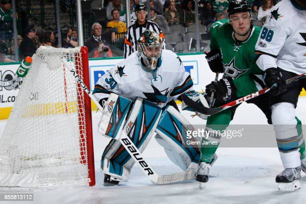 Aaron Dell of the San Jose Sharks tends goal against the Dallas Stars at the American Airlines Center on March 20 2017 in Dallas Texas