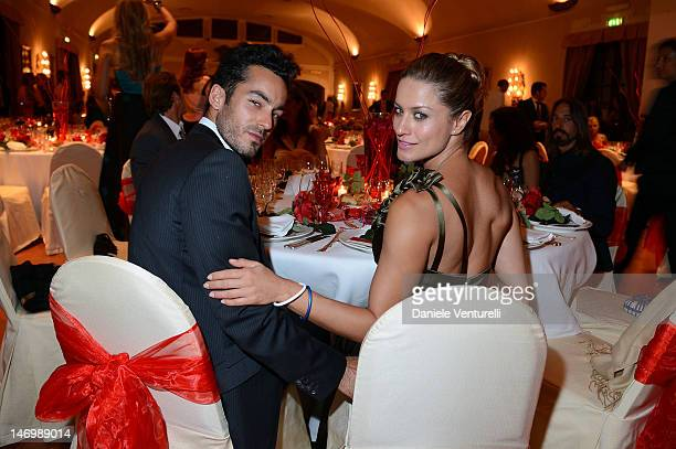 Aaron Diaz and Lola Ponce attend the 'Haiti Charity Gala Event' during the 58th Taormina Film Fest at San Domenico Palace on June 24 2012 in Taormina...