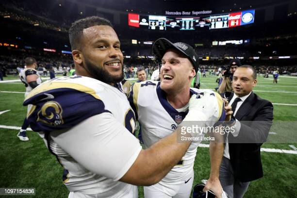 Aaron Donald and Greg Zuerlein of the Los Angeles Rams celebrate after defeating the New Orleans Saints in the NFC Championship game at the...