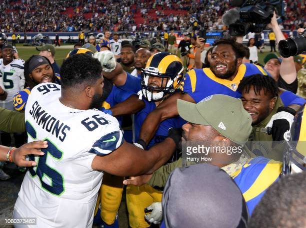 Aaron Donald of the Los Angeles Rams and Jordan Simmons of the Seattle Seahawks push and shove at the end of the game after a 3631 Rams win at Los...