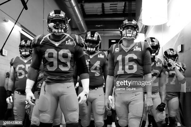 Aaron Donald of the Los Angeles Rams and teammate Jared Goff lead their teammates through the tunnel prior Super Bowl LIII at MercedesBenz Stadium on...