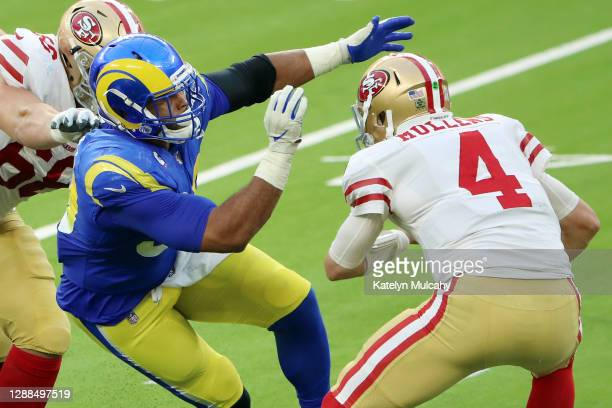 Aaron Donald of the Los Angeles Rams attempts to sack Nick Mullens of the San Francisco 49ers during the first half at SoFi Stadium on November 29,...