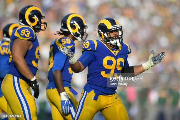Aaron Donald of the Los Angeles Rams celebrates after he sacked Aaron Rodgers of the Green Bay Packers at Los Angeles Memorial Coliseum on October 28...