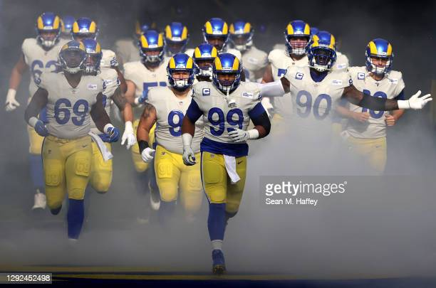 Aaron Donald of the Los Angeles Rams leads the team out to the field prior to facing the New York Jets at SoFi Stadium on December 20, 2020 in...