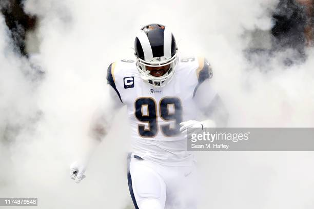 Aaron Donald of the Los Angeles Rams runs onto the field as he is introduced before the game against the New Orleans Saints at Los Angeles Memorial...