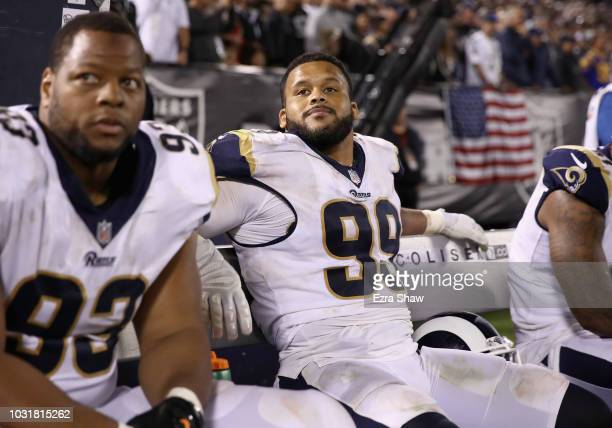 Aaron Donald of the Los Angeles Rams sits on the bench during their game against the Oakland Raiders at OaklandAlameda County Coliseum on September...