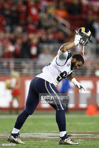 Aaron Donald of the Los Angeles Rams slams his helmet to the turf after being ejected for contact with an official during the NFL game against the...