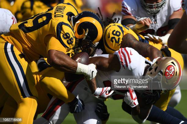 Aaron Donald of the Los Angeles Rams strips the ball from Matt Breida of the San Francisco 49ers during their NFL game at Levi's Stadium on October...