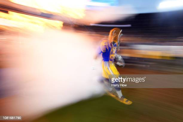 Aaron Donald of the Los Angeles Rams takes the field before the NFC Divisional Playoff game against the Dallas Cowboys at Los Angeles Memorial...