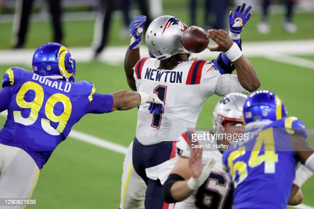 Aaron Donald of the Los Angeles Rams tips a pass attempt by Cam Newton of the New England Patriots during the second quarter in the game at SoFi...