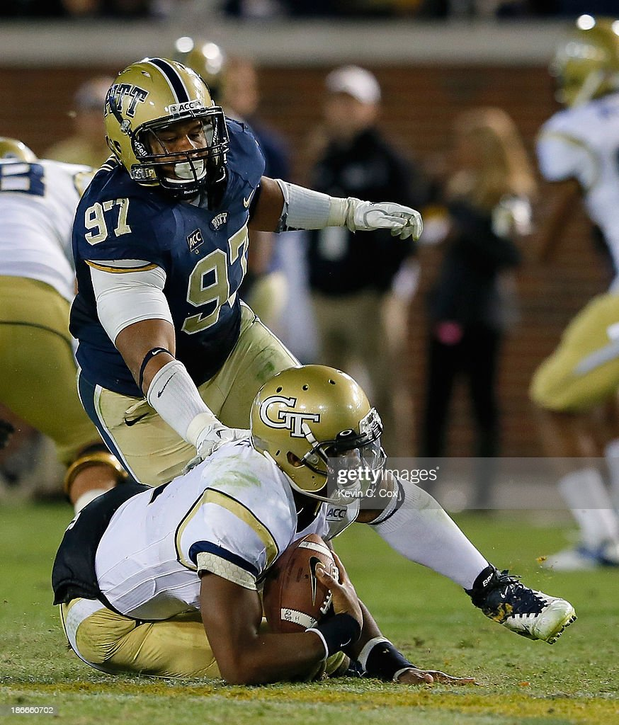 Aaron Donald #97 of the Pittsburgh Panthers sacks Vad Lee #2 of the Georgia Tech Yellow Jackets at Bobby Dodd Stadium on November 2, 2013 in Atlanta, Georgia.