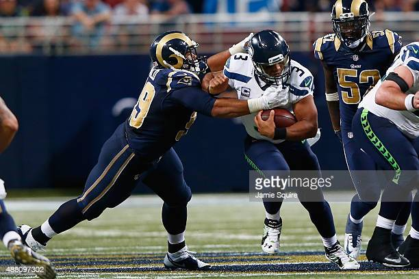 Aaron Donald of the St Louis Rams sacks Russell Wilson of the Seattle Seahawks in overtime to win the game 3431 at the Edward Jones Dome on September...