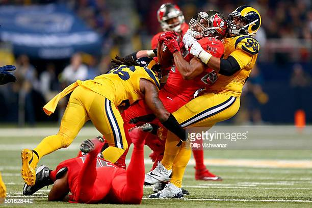 Aaron Donald of the St Louis Rams takes down Doug Martin of the Tampa Bay Buccaneers for a failed fourth down in the second quarter at the Edward...