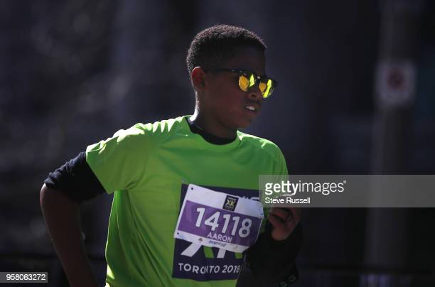 TORONTO ON MAY 13 Aaron Dover sprints to the finish line The Sporting Life 10 K drew over 22000 runners down Yonge Street raising over 2 million...