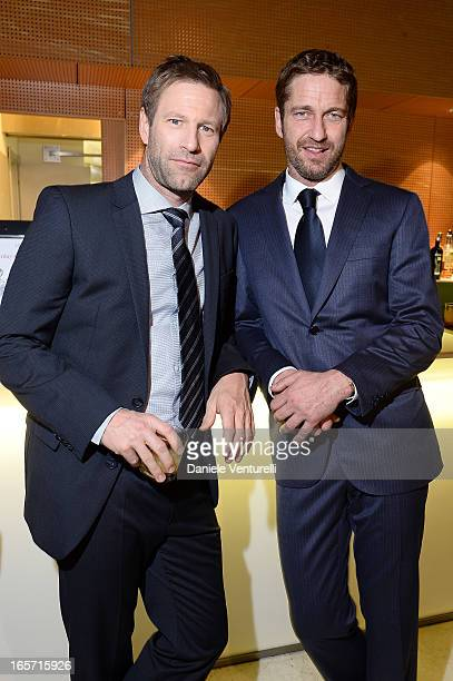 Aaron Eckhart and Gerard Butler attend the gala dinner by Antonello Colonna for the movie 'Olympus Has Fallen' on April 5 2013 in Rome Italy