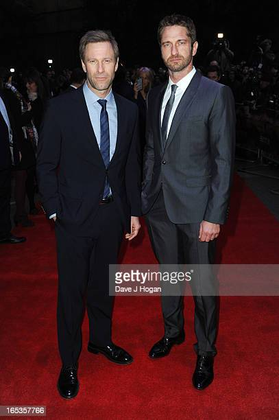 Aaron Eckhart and Gerard Butler attend the UK premiere of 'Olympus Has Fallen' at The IMAX on April 03 2013 in London England
