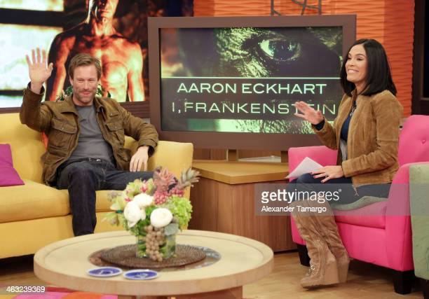 Aaron Eckhart and Karla Martinez are seen on the set of Univision's 'Despierta America' at Univision Headquarters on January 17 2014 in Miami Florida