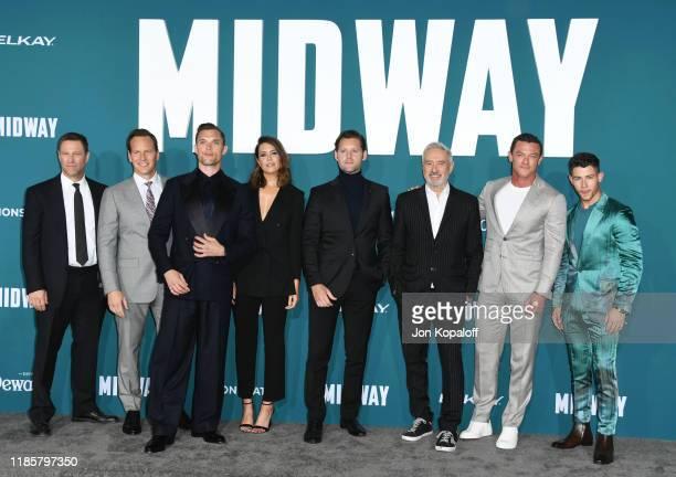 Aaron Eckhart Patrick Wilson Ed Skrein Mandy Moore Luke Kleintank Roland Emmerich Luke Evans and Nick Jonas attend the premiere of Lionsgate's Midway...