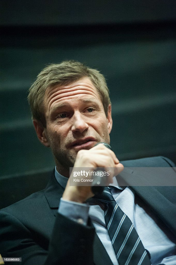 Aaron Eckhart speaks during the 'Olympus Has Fallen' screening at AMC Loews Georgetown 14 on March 12, 2013 in Washington, DC.