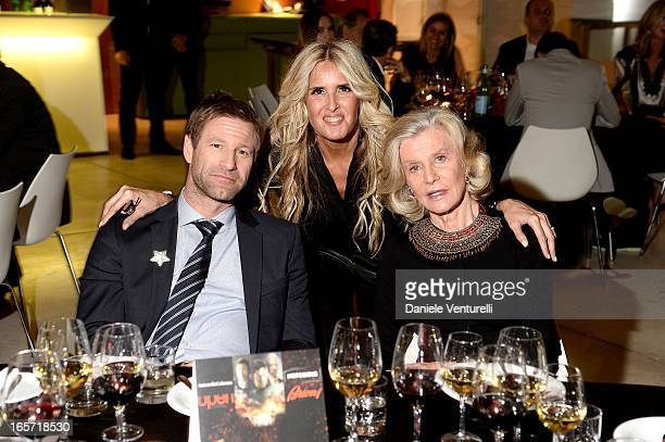 Aaron Eckhart Tiziana Rocca and Marina Cicogna attend a gala dinner by Antonello Colonna for the movie 'Olympus Has Fallen' on April 5 2013 in Rome...