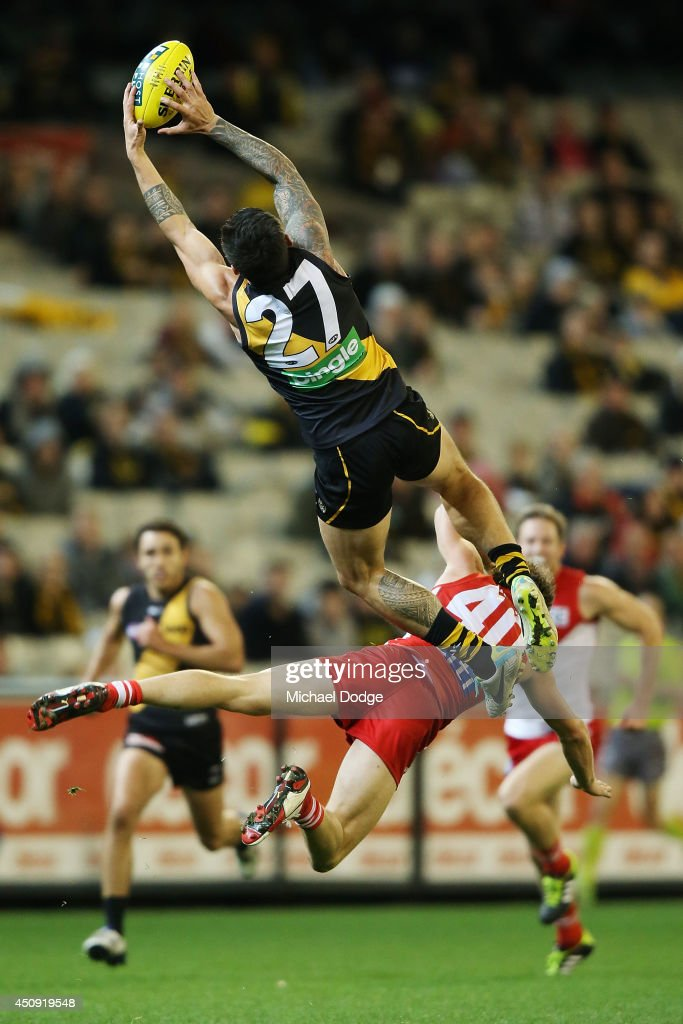 Aaron Edwards of the Tigers takes a high mark over Nick Smith of the Swans during the round 14 AFL match between the Richmond Tigers and the Sydney Swans at Melbourne Cricket Ground on June 20, 2014 in Melbourne, Australia.