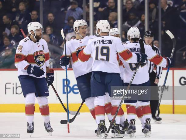 Aaron Ekblad Nick Bjugstad Mike Matheson Jamie McGinn and Denis Malgin of the Florida Panthers celebrate a first period goal against the Winnipeg...