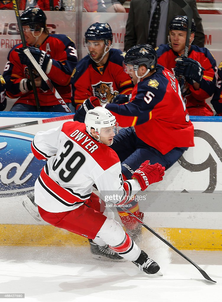 Aaron Ekblad #5 of the Florida Panthers and Patrick Dwyer #39 of the Carolina Hurricanes come together along the boards during third period action at the BB&T Center on April 2, 2015 in Sunrise, Florida. The Panthers defeated the Hurricanes 6-1.
