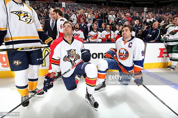 Aaron Ekblad of the Florida Panthers and Team Toews and John Tavares of the New York Islanders and Team Toews kneel on the ice during the Bridgestone...