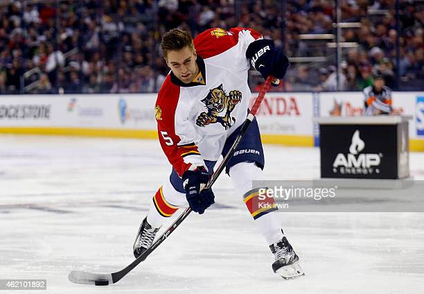 Aaron Ekblad of the Florida Panthers and Team Toews takes a shot during the AMP NHL Hardest Shot event of the 2015 Honda NHL AllStar Skills...