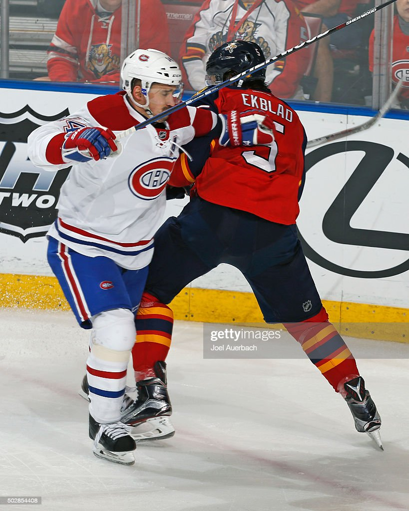 Aaron Ekblad #5 of the Florida Panthers and Tomas Plekanec #14 of the Montreal Canadiens come together during third period action at the BB&T Center on December 29, 2015 in Sunrise, Florida. The Panthers defeated the Canadiens 3-1.
