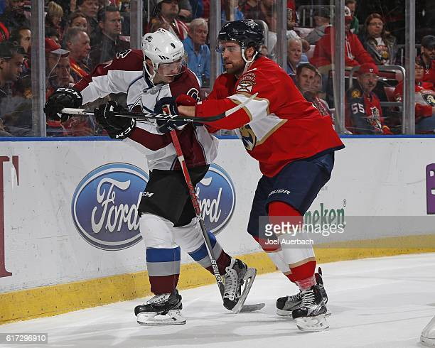 Aaron Ekblad of the Florida Panthers battles with Matt Duchene of the Colorado Avalanche behind the net during second period action at the BBT Center...