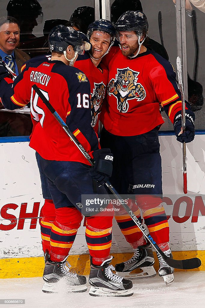 Aaron Ekblad #5 of the Florida Panthers celebrates his goal with teammates Jonathan Huberdeau #11 and Aleksander Barkov #16 against the Washington Capitals at the BB&T Center on December 10, 2015 in Sunrise, Florida.