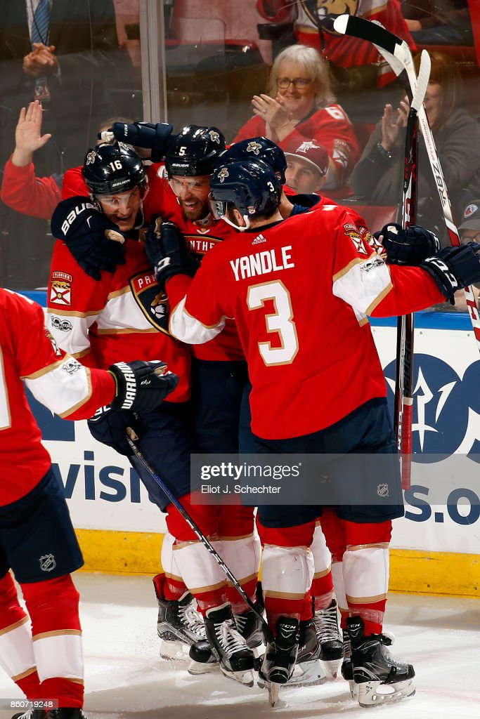 Aaron Ekblad #5 of the Florida Panthers celebrates his goal with teammates against the St. Louis Blues at the BB&T Center on October 12, 2017 in Sunrise, Florida.