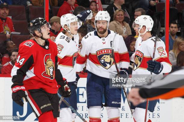 Aaron Ekblad of the Florida Panthers celebrates his second period goal with teammates Henrik Borgstrom and Mike Matheson as JeanGabriel Pageau of the...