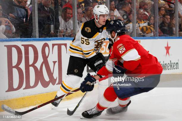 Aaron Ekblad of the Florida Panthers defends against Noel Acciari of the Boston Bruins during second period action at the BBT Center on March 23 2019...