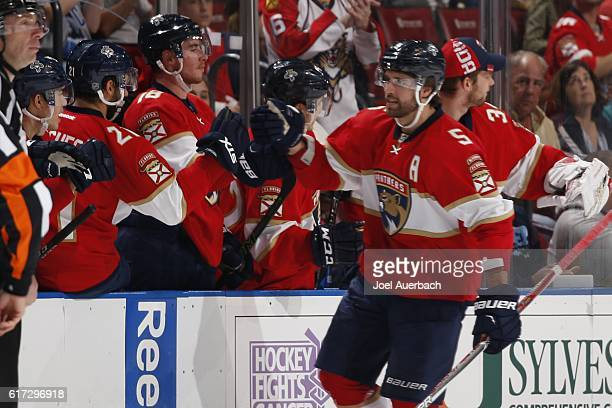 Aaron Ekblad of the Florida Panthers is congratulated after scoring a second period goal to tie the game against the Colorado Avalanche at the BBT...