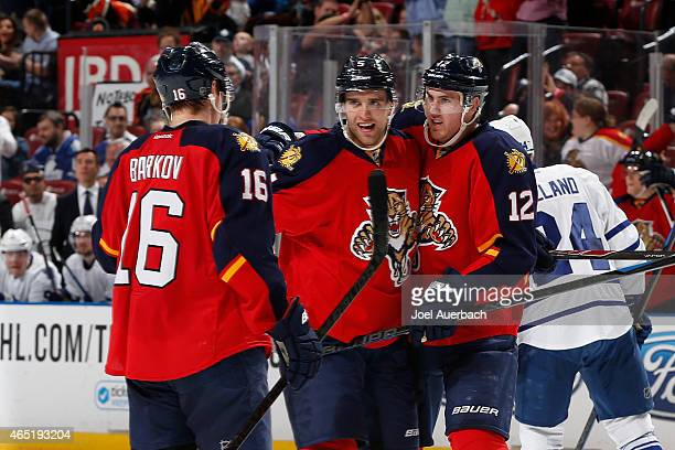 Aaron Ekblad of the Florida Panthers is congratulated by Jimmy Hayes and Aleksander Barkov after scoring a secondperiod goal against the Toronto...