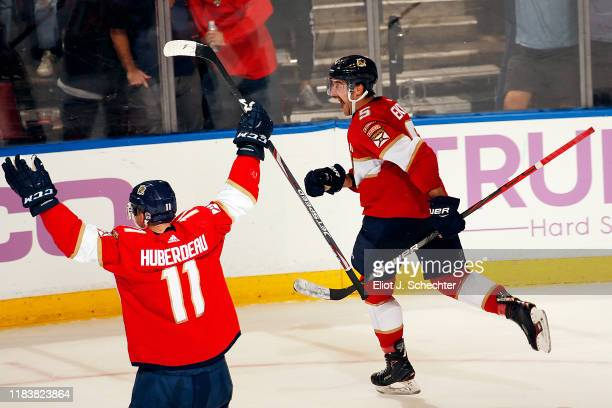 Aaron Ekblad of the Florida Panthers reacts to scoring in overtime for the win against the Anaheim Ducks at the BB&T Center on November 21, 2019 in...