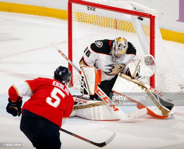 Aaron Ekblad of the Florida Panthers scores in overtime for the win against Goaltender John Gibson of the Anaheim Ducks at the BB&T Center on...
