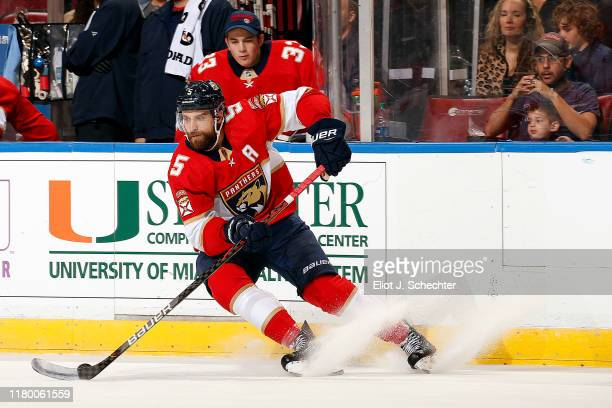 Aaron Ekblad of the Florida Panthers skates with the puck against the Carolina Hurricanes at the BB&T Center on October 8, 2019 in Sunrise, Florida.