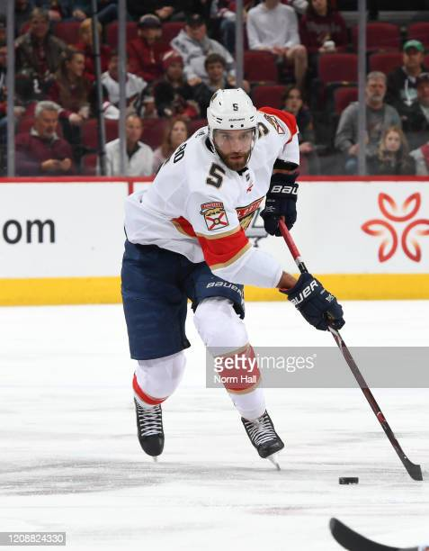 Aaron Ekblad of the Florida Panthers skates with the puck against the Arizona Coyotes at Gila River Arena on February 25 2020 in Glendale Arizona