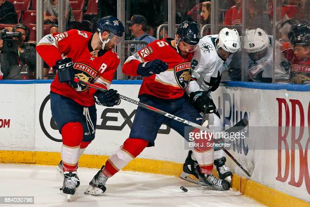 Aaron Ekblad of the Florida Panthers smashes Joel Ward of the San Jose Sharks into the boards during second period action at the BBT Center on...