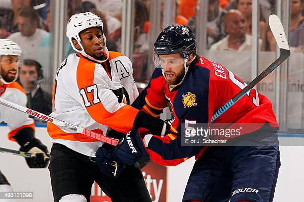Aaron Ekblad of the Florida Panthers tangles with Wayne Simmonds of the Philadelphia Flyers at the BBT Center on October 10 2015 in Sunrise Florida