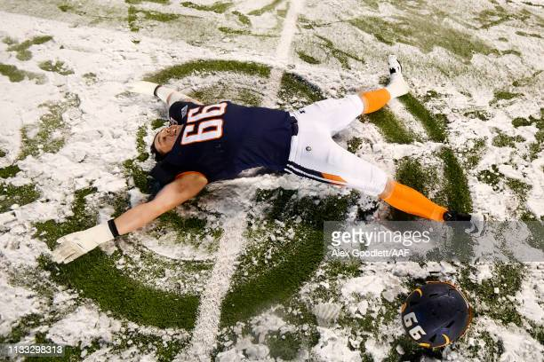 Aaron Evans of Orlando Apollos makes a snow angel following their 2011 win over the Salt Lake Stallions in their Alliance of American Football game...