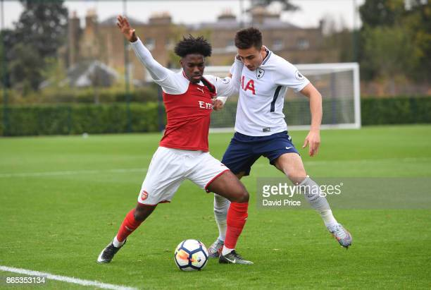 Aaron Eyoma of Arsenal is held back by Anthony Georgiou of Tottenham during the match between Tottehma Hotspur and Arsenal on October 23 2017 in...